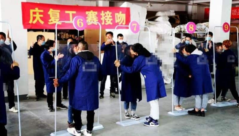 While world suffers from coronavirus spread, China organises kissing competition as part of factory reopening