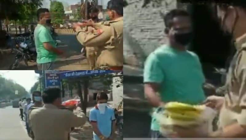 police performs aarti and give banana of lockdown violators in up
