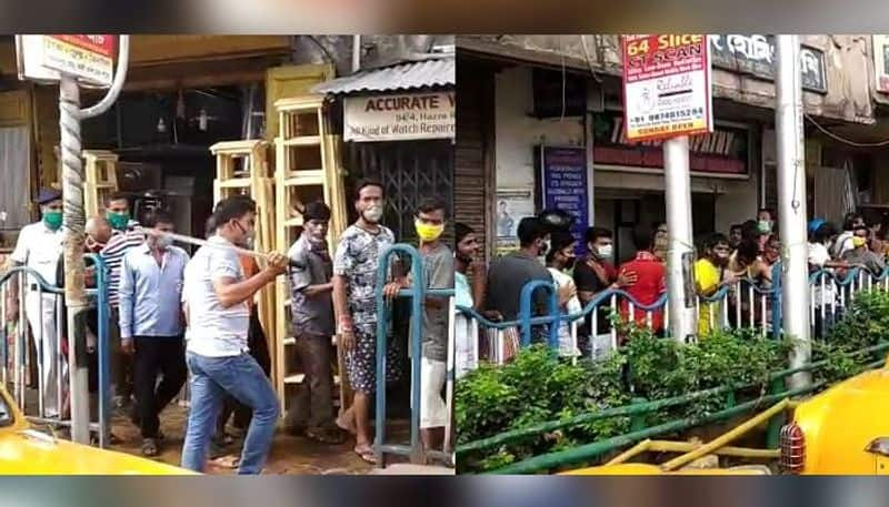 144 violated due to queue for liquor police lathi charged in Harish Mukherjee street
