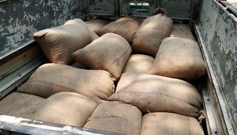 Police recovers food grains from a pick up van in Malda