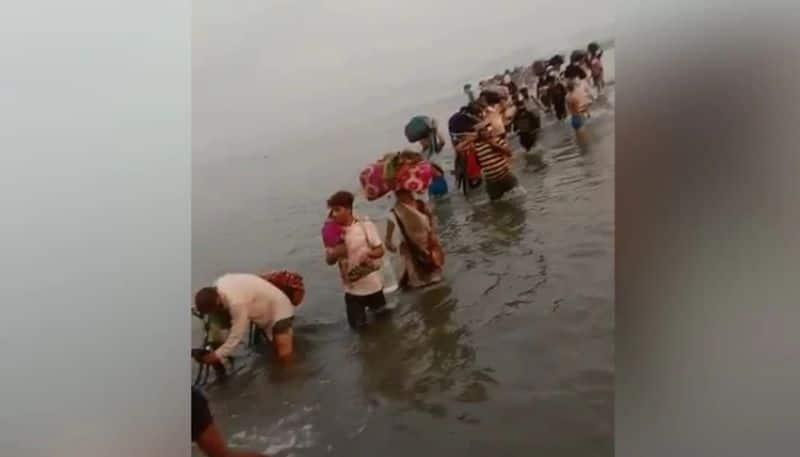 Covid 19: Migrants Crossing Knee-Deep Yamuna To Get Home
