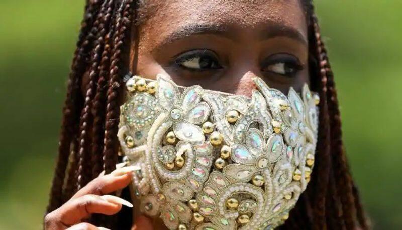 nigerian fashion stylist wears designer mask to set a model amid coronavirus outbreak