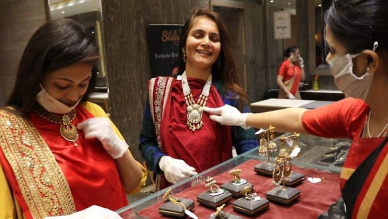Gold silver shine, dollar slows down before Dhanteras