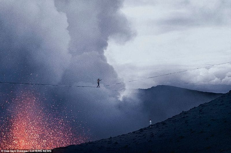 Two men created history by walking above a volcano on a rope