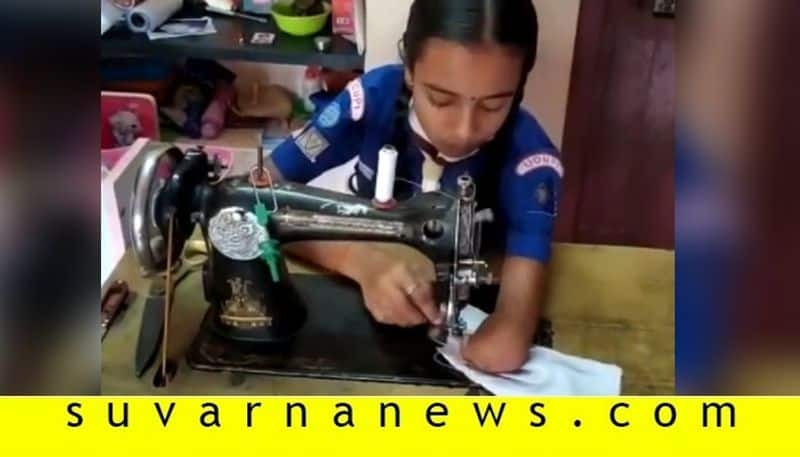Physically challenged girl stitches mask at home