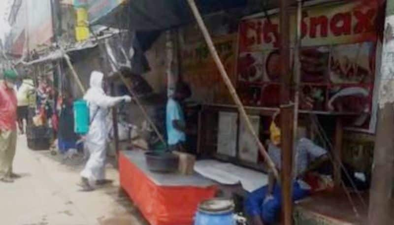 Corona patient sells puffed rice in a busy are at Malda town
