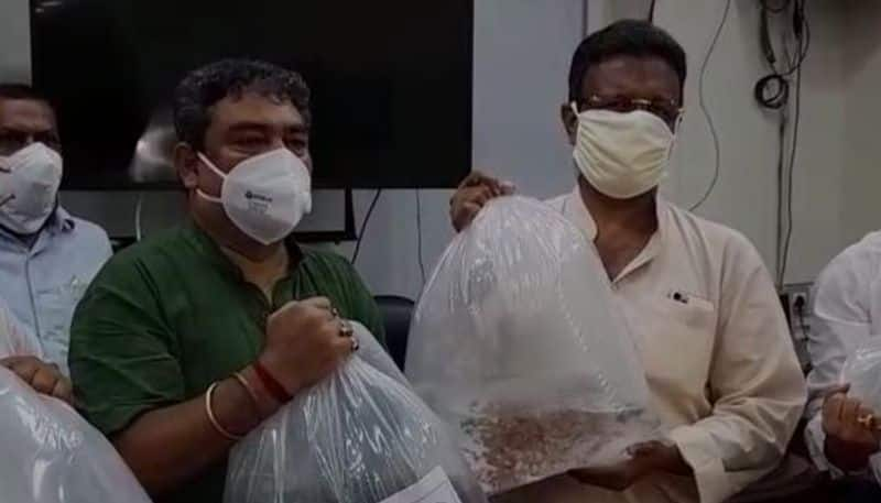 Guppy fish distributed in KMC to fight against dengue RT