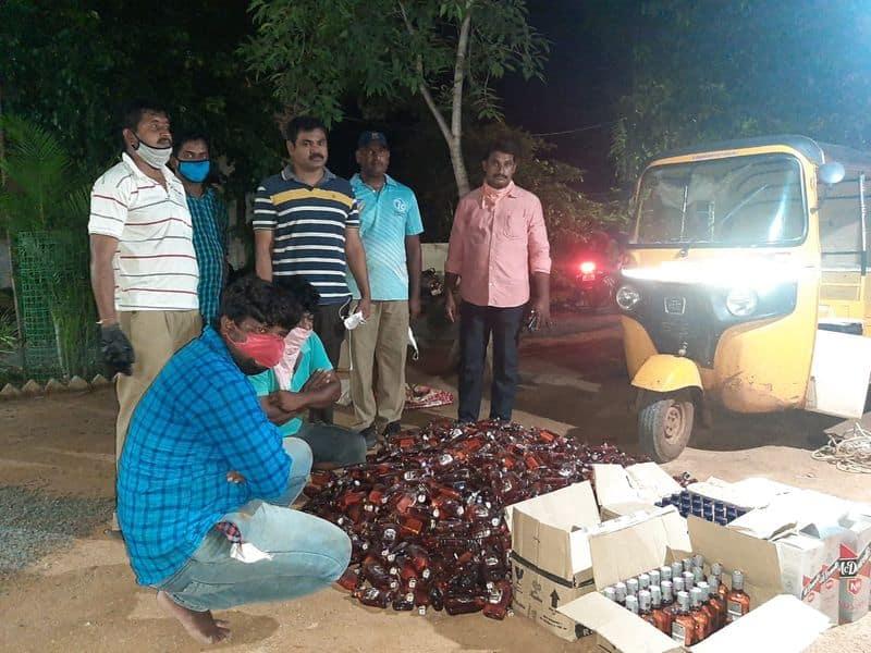 1270 liquor bottles seized, two arrested in jaggayyapet