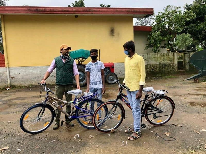 Karnataka rains: Father-son duo donates bicycles to students, workers in flood-affected Kodagu-dmn
