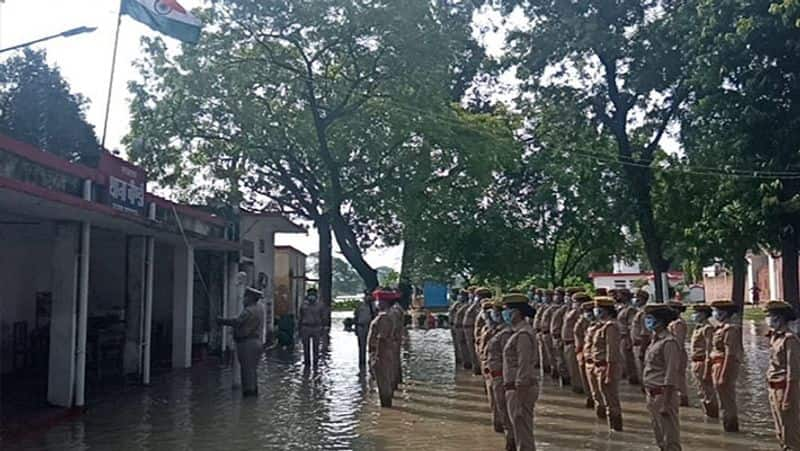 Flood water could not change the spirit of UP Police singing national anthem standing in knee water kpl