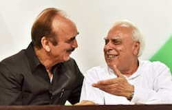 <p>Ghulam Nabi Azad and Kapil Sibal</p>