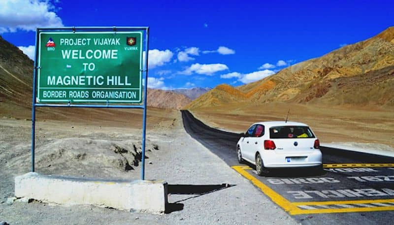 3. Anti-gravity hills in LadakhWith the anti-gravitational effect, this is the only magnetic hill in India. Objects and cars on the hill road may appear to roll uphill in defiance of gravity when they are, in fact, rolling downhill. This is landmarked by a yellow notice board that gives out instructions to place your car on neutral gear right on the spot marked by white paint, which will leave you surprised as your car will begin to move uphill on its own.