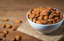 <p><strong>Almonds:</strong> Almonds are the best source of natural vitamin, Eyou. One must have at least 10-15 almonds a day. Many people debate on how to eat almonds - soaked or as is. The answer is to just eat them regularly - it doesn't really matter how to eat them. Eating almonds every day will keep your skin problems like dryness, wrinkles and ageing at bay, and make sure you eat gulbandi or marmara almonds as they have higher amount of vitamin E. This nutritious nut supports the production of collagen and is packed with calcium, making it an excellent superfood for hair, teeth, nails and skin.</p>