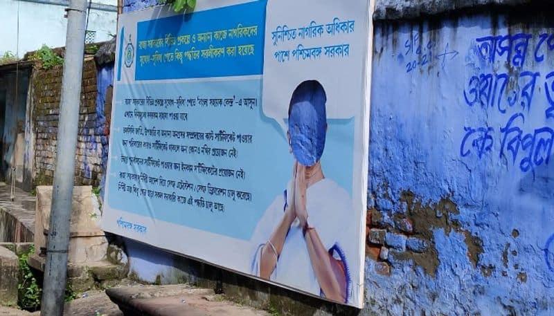A flex with photo of Mamata Banerjee destroyed in Jhalda at Purulia BTG