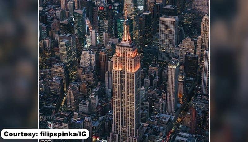 Diwali United States iconic Empire Building lit up in orange lights