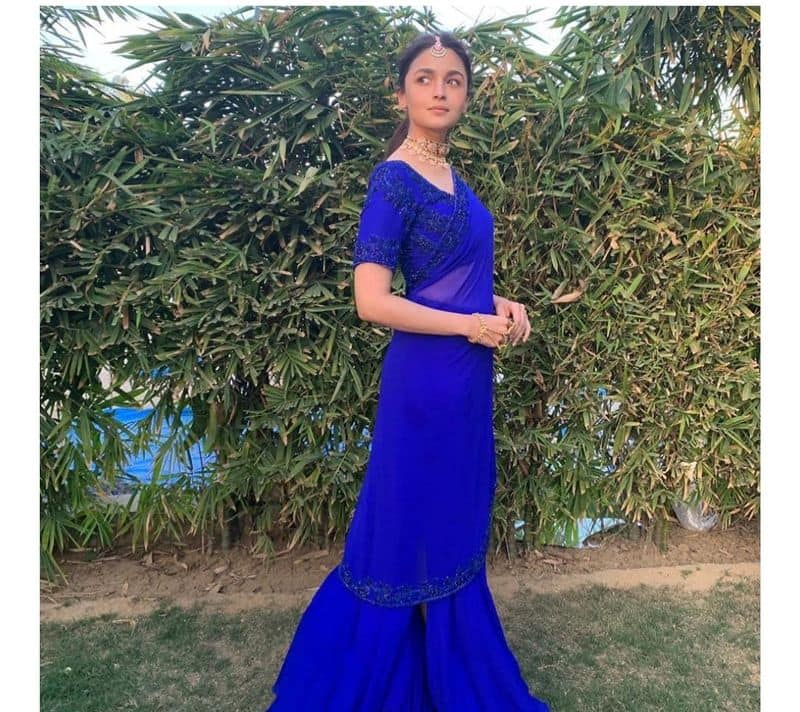 """<p style=""""text-align: justify;""""><strong>A solid colour breezy saree</strong></p>  <p style=""""text-align: justify;"""">Alia Bhatt wore a classic Manish Malhotra's sheer Royal blue coloured saree at her bestie's wedding shenanigans. The actress completed her look with a contrasting pink-stone choker, mang tika, and nude makeup. Looking very Indian and chic.</p>  <p style=""""text-align: justify;"""">&nbsp;</p>"""