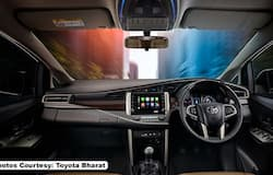 """<p>The driver dashboard of the new Innova Crysta is decked with a new 8"""" display with Android Auto and Apple CarPlay. It is also loaded with advanced connectivity functions like real-time vehicle tracking, geofencing and houses a crystal clear instrument cluster</p>"""