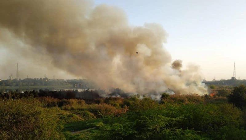 Fire on Bellanadur Lake in Bengaluru  grg
