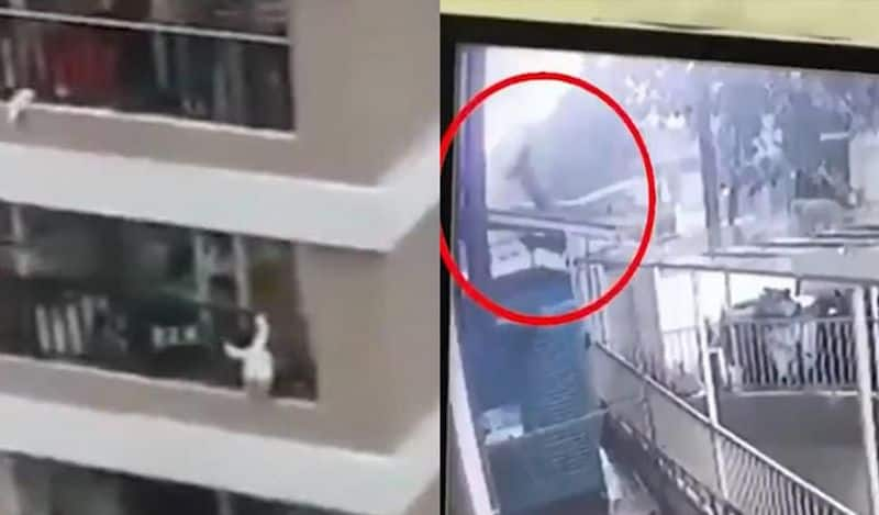 watch viral video of 2 year old girl fell from 12th floor delivery boy catches her bsm