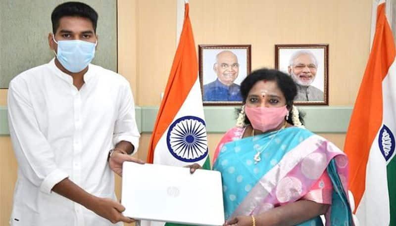 telangana governor tamilisai helps poor student, presenting laptop - bsb
