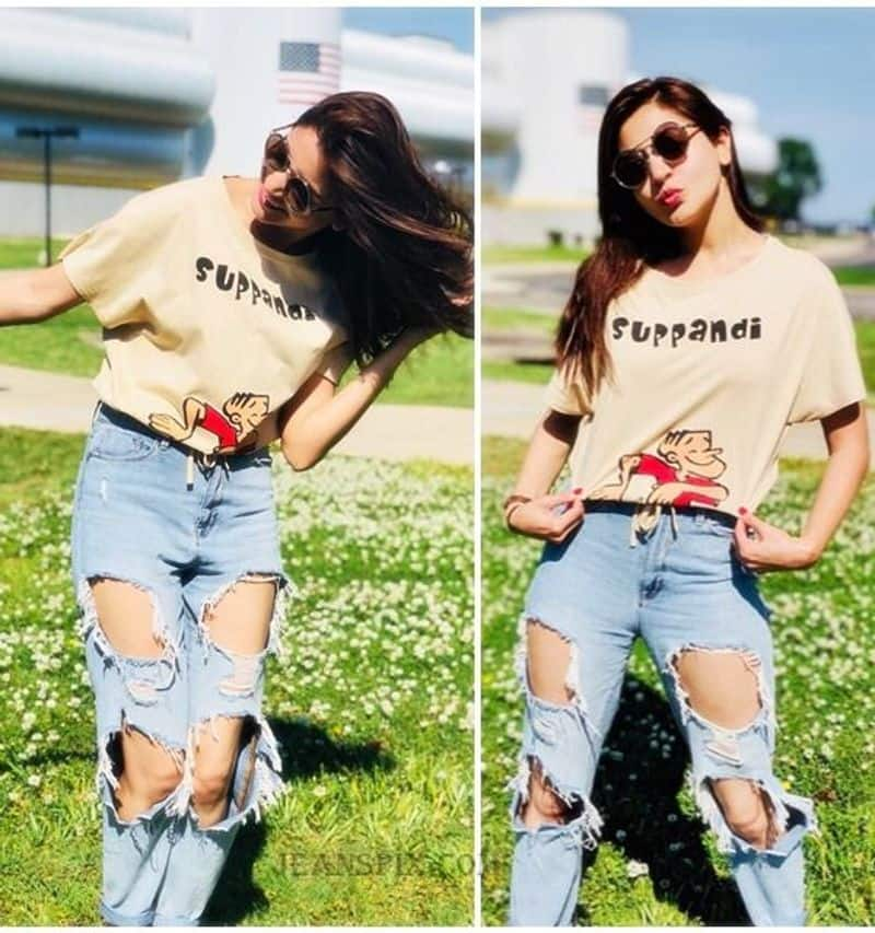 """<p style=""""text-align: justify;""""><strong>Anushka Sharma</strong><br /> Anushka Sharma's quirky ripped jeans look is worth recreating. She wore a beige 'Suppandi' graphic printed t-shirt with ripped blue jeans.</p>"""