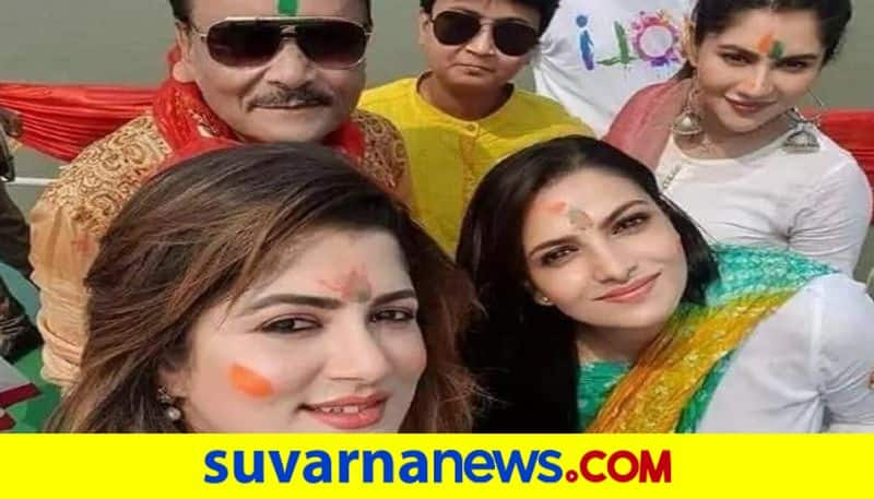 TMC candidate Madan Mitra celebrates Holi with BJP nominees on Hooghly river pod