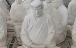 <p>trump budhdhist statue</p>