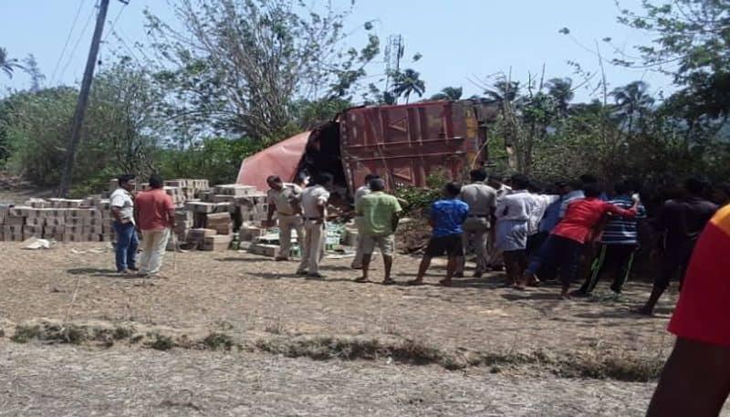 people Full happy after alcohol Loaded lorry overturnes Near Ankola rbj