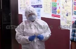 <p>cm daughter veena cast vote by wearing ppe kit</p>