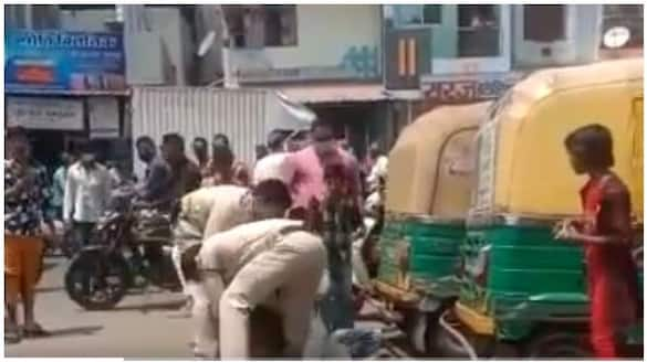 Police assault autorickshaw driver for not wearing mask properly in indore ksp