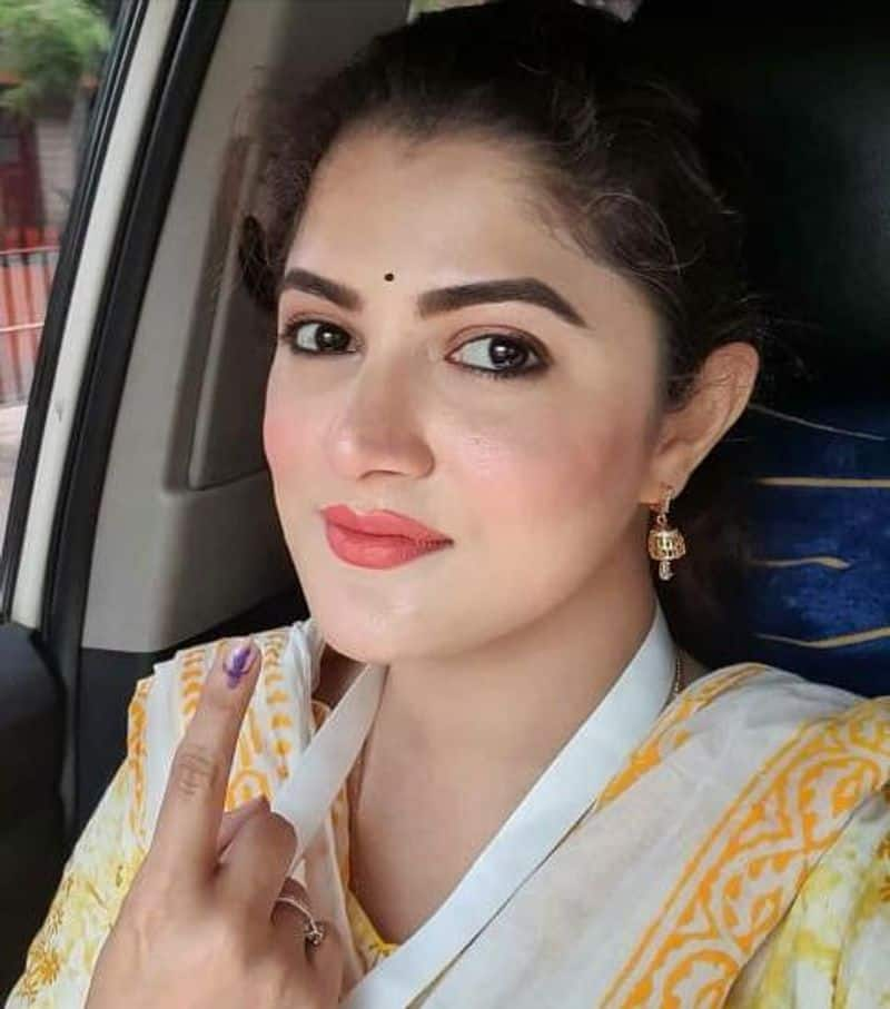 """<p style=""""text-align: justify;""""><strong>Srabanti Chatterjee</strong><br /> Srabanti shared a selfie looking absolutely pretty in a white and yellow salwar suit showing her index finger as she has given her vote.</p>"""