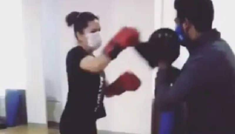 Sunny Leone s  Boxing With Her Mask On