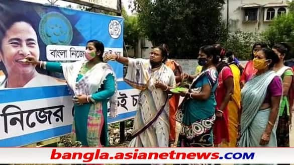 Women in Nadia plays conch shells, to celebrate the third time swearing in of Mamata banerjee ALB