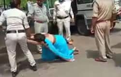<p>woman thrashed by policemen</p>