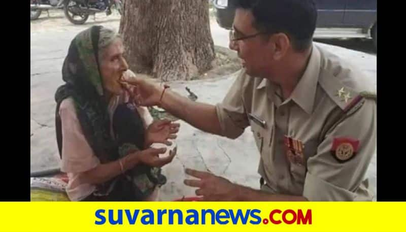 Cop feeds poori and sabji to elderly woman picture goes viral pod