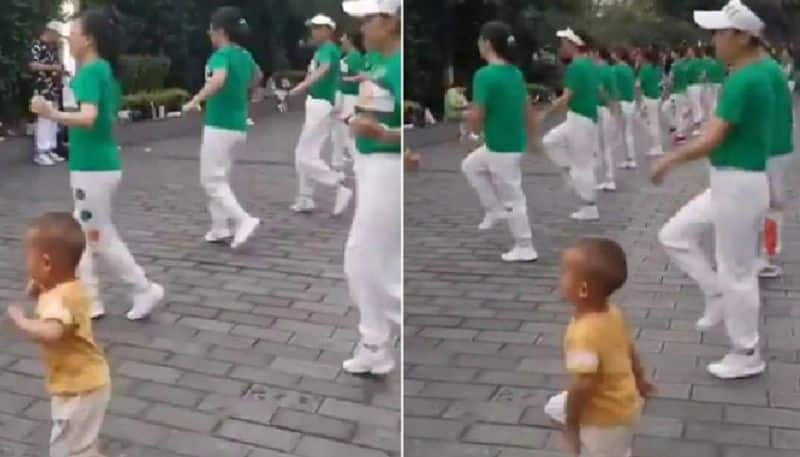 kid dancing among adult dancers video goes viral