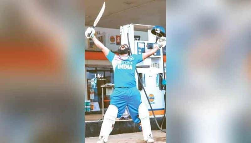 Man plays cricket in petrol pumb as a Protest against petrol price hike
