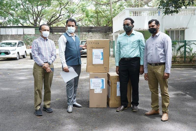 Chennai iit old students trust handover 200 oxygen Condensers to Karnataka Govt mah