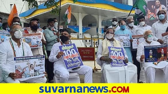 Karnataka Congress begins 100 not out protest against petrol price hike pod