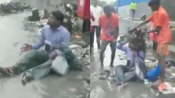 Shiv Sena MLA Dilip Lande forces a contractor to sit in a pile of garbage in mumbai bmm