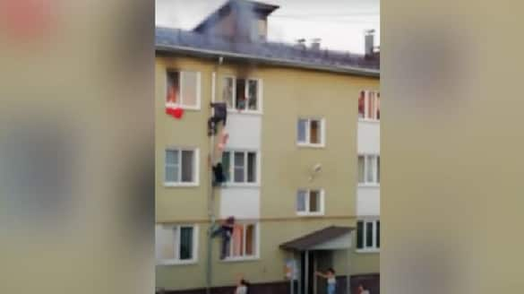 viral video in which men rescues children from fire
