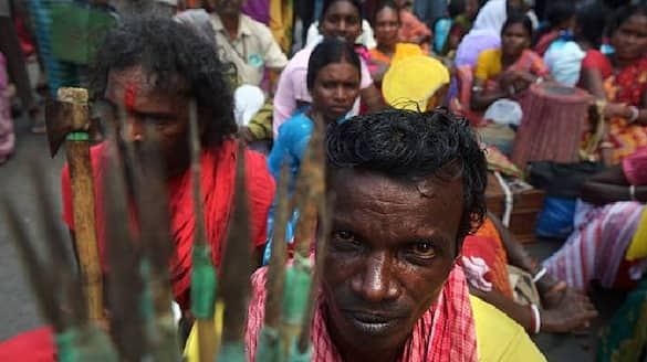 tribals show protest bows and arrows against Land mafia  bpsb