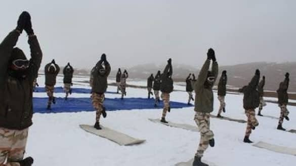 ITBP personnel perform Yoga at over 18,000 feet in Ladakh amid snow conditions -- Watch bpsb