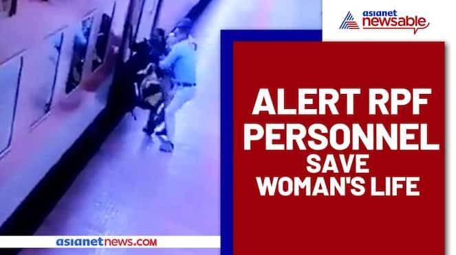 Passenger slips while trying to board Rajdhani Express, RPF staff saves her - vpn