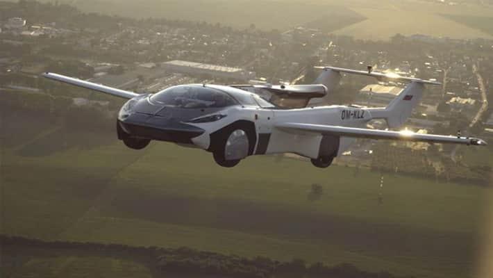 রূপকথা নয়, বাস্তবের মাটি ছেড়ে আকাশে উড়ল চারচাকা গাড়ি   Flying car now a  reality, AirCar completes first ever inter-city flight bmm