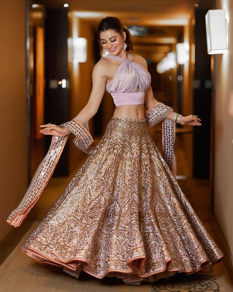 Urvashi Rautela shared stunning pictures in a golden dress Watch Hot Style