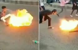 <p>Young boys playing with fire in middle of the road shocks internet; Watch the video</p>