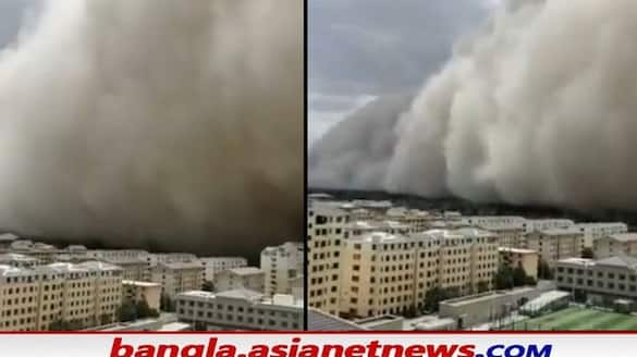 watch viral video of powerful sandstorms in china 300 foot wall of sand bsm
