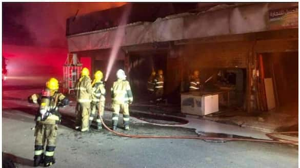 four shops in kuwait catches fire