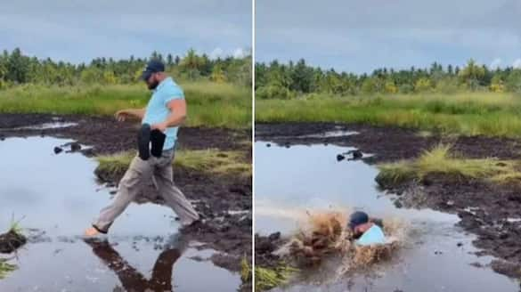 Husband fell down in muddy water wife laughs video